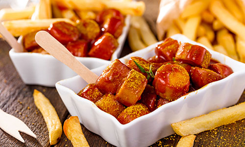 Sample the currywurst in Berlin, Germany